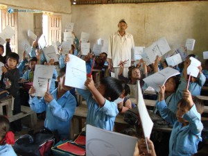 3. All students show their gifts of pencils and copies