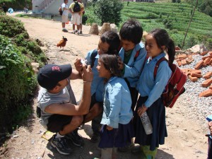 43. Hitesh snapping pictures of Government public Community School children