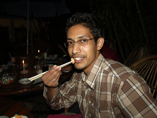 07-ravi-happy-with-chopstick.JPG