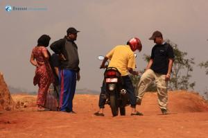 33. Suraj helping a biker start his bike but I guess he needed a mechanic.
