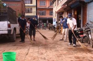 16. Brooming in front of Broom Shop