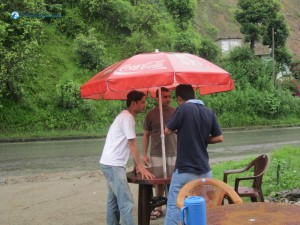 1. Having tea under Coca Cola Umbrella on rainy day