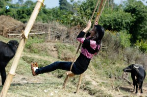 24. Swinging on the swing