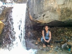 33. Lady near to small waterfalls