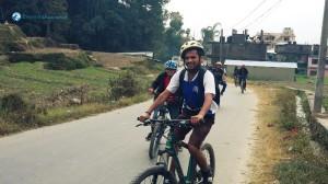 21. Holding Bike